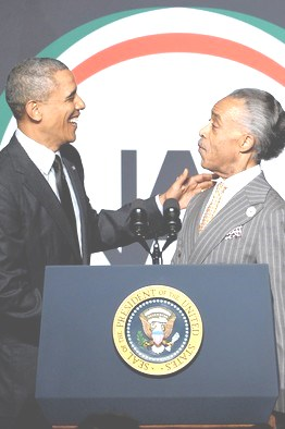 President Obama, left, told Rev. Al Sharpton's civil rights group that the future of voting rights is in grave danger.