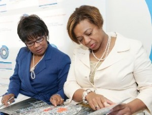 UIC Chancellor Paula Allen-Meares (left) and Illinois Sen. Patricia Van Pelt (right) review UIC's bid for the Obama Presidential Library. Photo by Roberta Dupius-Devlin/UIC Photo Services