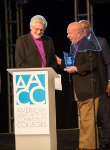 Dr. Terry O'Banion, left, and Dr. John E. Roueche take center stage at the AACC luncheon.