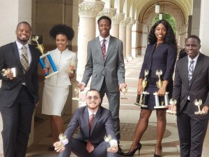 Members of the Wiley debate team pose with their awards.